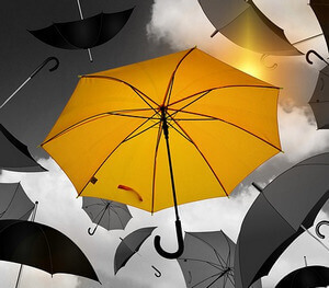 bright yellow umbrella among grey umbrellas by geralt at Pixabay