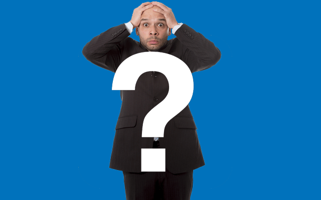a man with hands on his head looking worried - question mark in front of him
