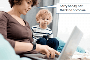 "lady working on a laptop computer with child beside her. She is saying ""Sorry honey, not that kind of cookie""."