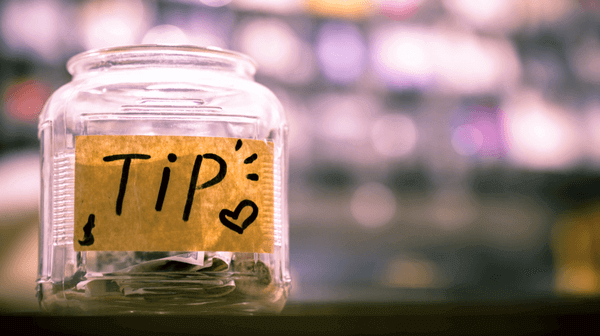 "a picture of a jar with a label stating ""Tips"""