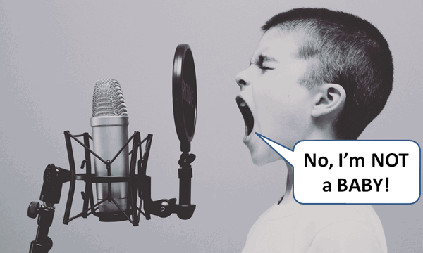 child screaming into podcast mic saying