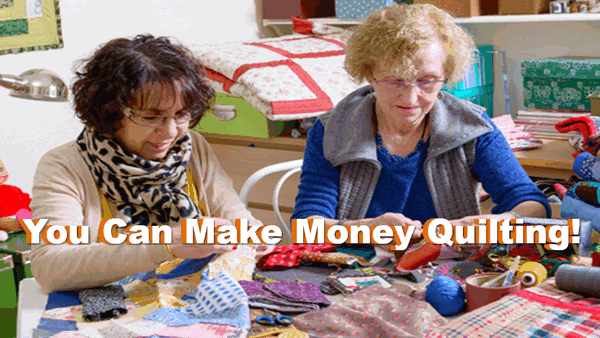 2 ladies working at creating a quilt