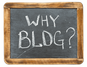 "hand-held chalkboard with ""Why Blog?"" on it"